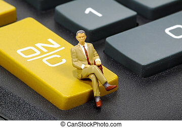 Accountant - Miniature Accountant Sitting on a Calculator.
