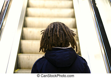 Dreadlocks - person with dreadlocks and escalator
