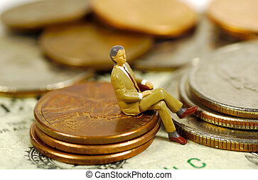 Banker 2 - Miniature Banker Sitting on Pennies. See...