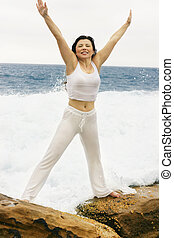 love Life - Woman on wave swept rocks