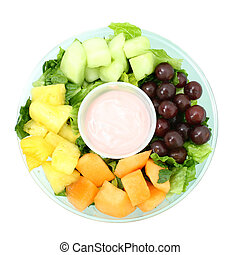 Fruit and Yogurt - Small fruit tray with cantaloupe,...