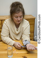 high blood pressure - older woman has high blood pressure