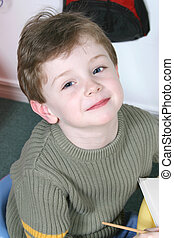 Boy Child Preschool - Handsome and happy little boy sitting...