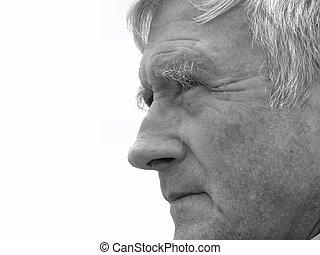 Watching - Elderly man carefully watching something