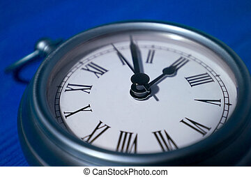 Pocket_Watch_H - Close up of brushed silver pocket watch.