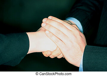 Warm handshake - Man and woman shaking hands