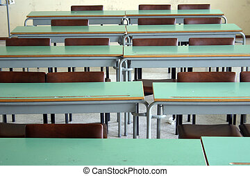 School desks - A view on desks from an empty classroom.