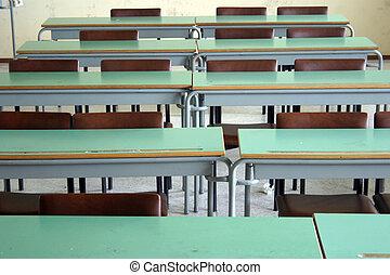 School desks - A view on desks from an empty classroom.