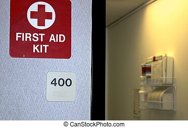First Aid Kit - Sign on door showing location of first aid...