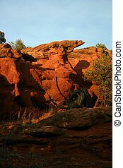 Sunset at Red Rocks - The setting sun deepens the red of the...