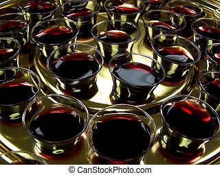 Communion Tray - Closeup of full glasses in communion tray