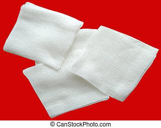 Cotton Bandage - White cotton bandage on red background