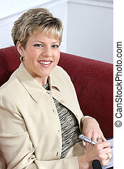 Business Woman Working at Home on Couch - Woman in business...