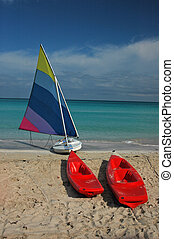 Sailboat and Kayaks - On the Beach at a Resort in the...
