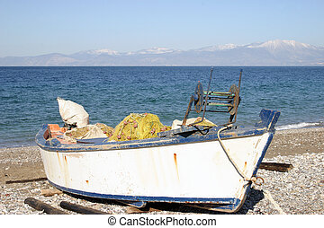 Fishing boat - Small fishing boat by the sea.
