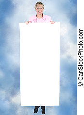 Add Text Woman - Woman holding a large blank sign for text...