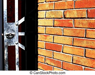 Brick Wall - Brick wall and metal gate This image has been...