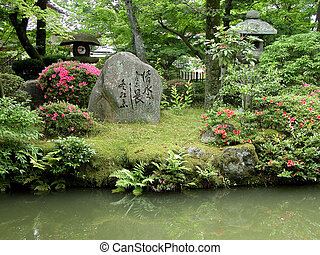 Japanese Garden - a japanese garden with a rocks and some...