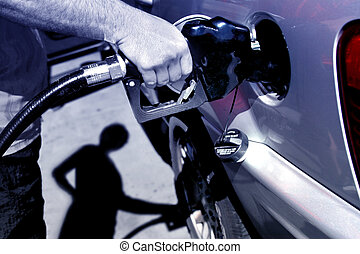 Fuel pump - A man filling gas on his car