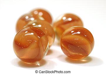 orange marbles - cluster of orange marbles