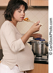 Cooked to perfection - Woman cooking in the kitchen