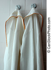 Spa Robes hanging in a Bathroom