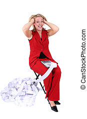 Budgets and Taxes - Woman in red working with a printing...