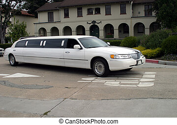 Limo Leaving Resort - White limousine leaving a resort.