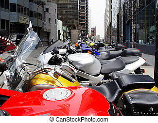 Bikes in a row - A row of colorful motorcycles in Montreal