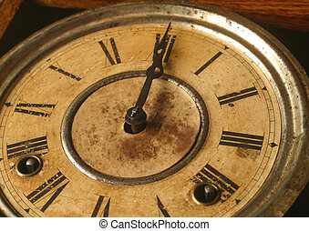 antique clock - An antique clock at twelve o'clock.