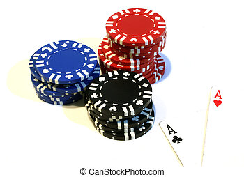 Poker Chips and Aces - Three stacks of poker chips red, blue...