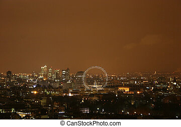 London by Night - Areil view of London at Night including...