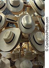 Souvenir Hats - Sun hats on sale in a Flea Market in...
