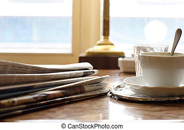 Sunday morning with coffee and newspapers