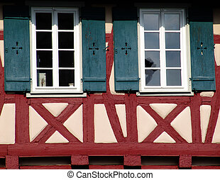 half-timbered - windows of a half-timbered house in swabia,...