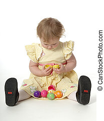 Easter egg baby - Baby girl is examining hollow easter eggs...