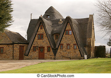 Thatch and Stone - An unusual English thatch cottage