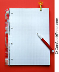 taking note - exercise book, pen, pin on red background