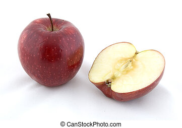 Red Apple - A red apple next to half an apple