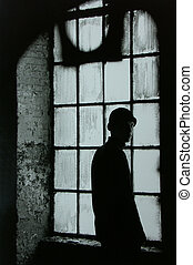caught - Portrait of man in abandonded warehouse.