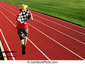 Boy on a racetrack 2 - Boy with a checked flag running on a...