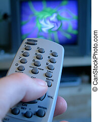 swiching - Person holding the remote control of TV.