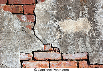 Concrete and Brick - Cracked concrete on brick wall.