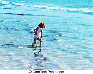 Boy on the beach - Kid playing in the ocean