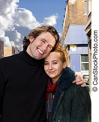 Love in the city - Smiling couple on a street