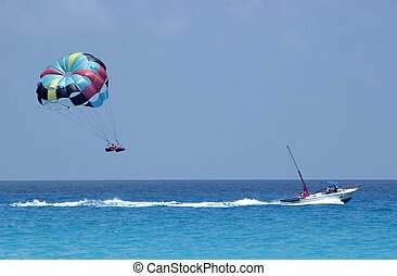Parasailing over Can - Parasailing over the Caribbean Sea,...