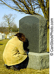 Mourning - Person Mourning at a Cemetery