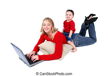 Mother Son Laptop - Mother and son sharing laptop time Shot...