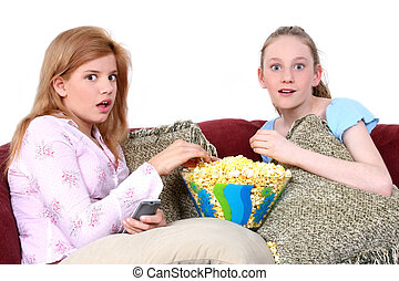 Teens Television - Two fourteen year old girls on the couch...