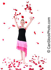 Carefree Teen Throwing Rose Petal Into The Air - Teen girl...